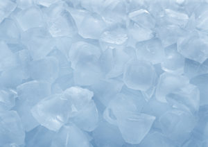 Fresh ice cubes in bulk close-up on white background