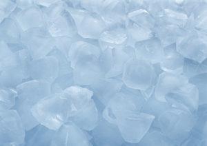 Fresh ice cubes in bulk close-up on white background